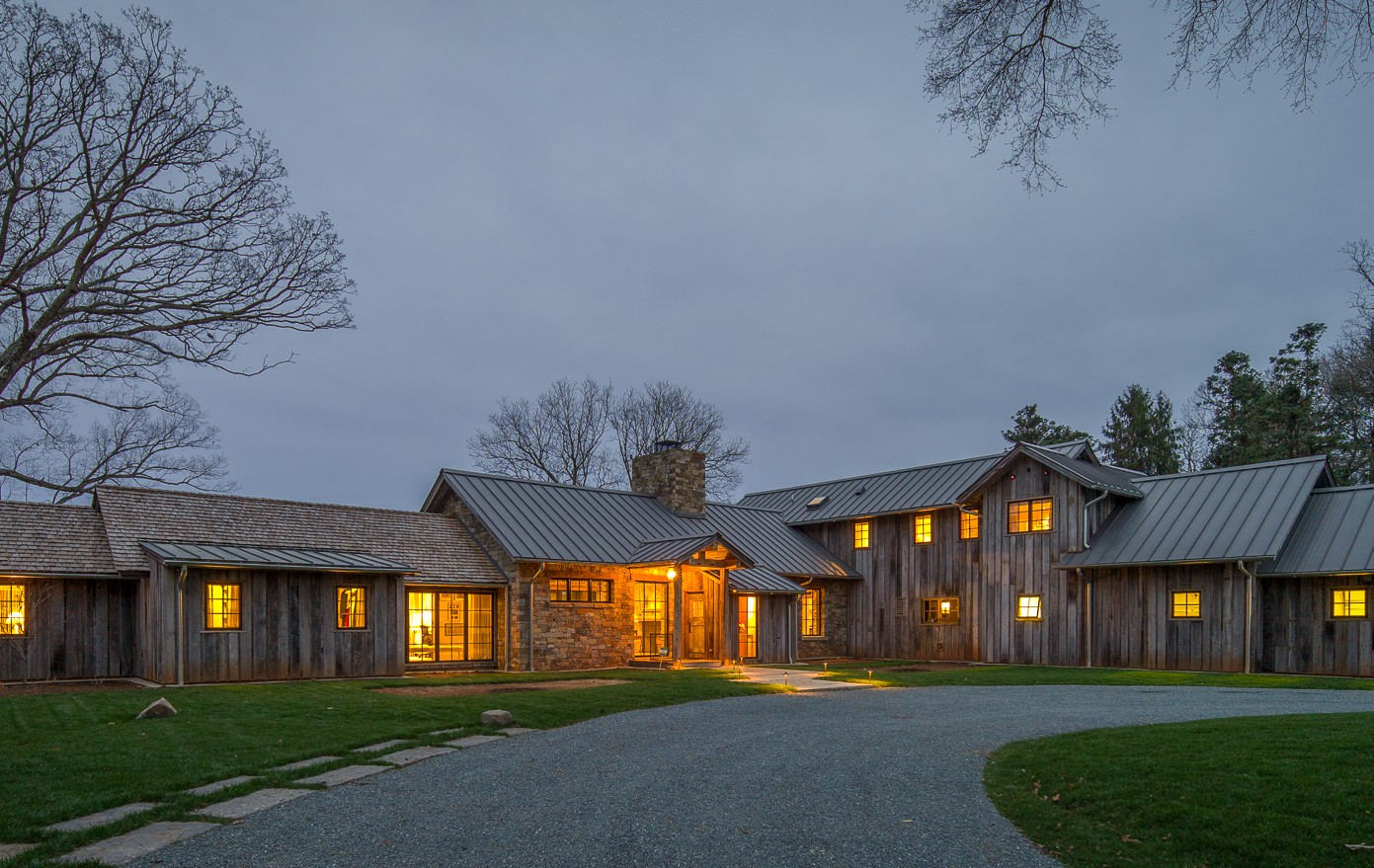 contemporary house with reclaimed barn siding