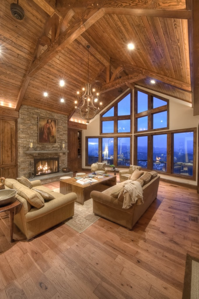 douglas fir timber frame king post trusses in mountain great room