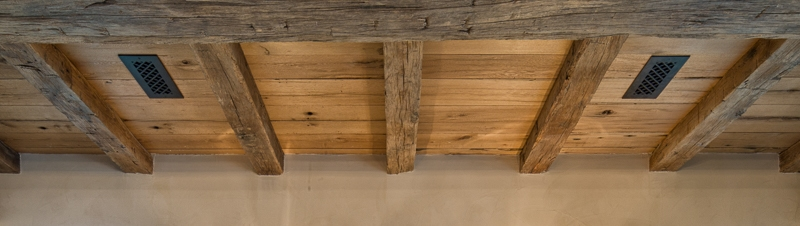 Reclaimed hand hewn beams and reclaimed ceiling boards