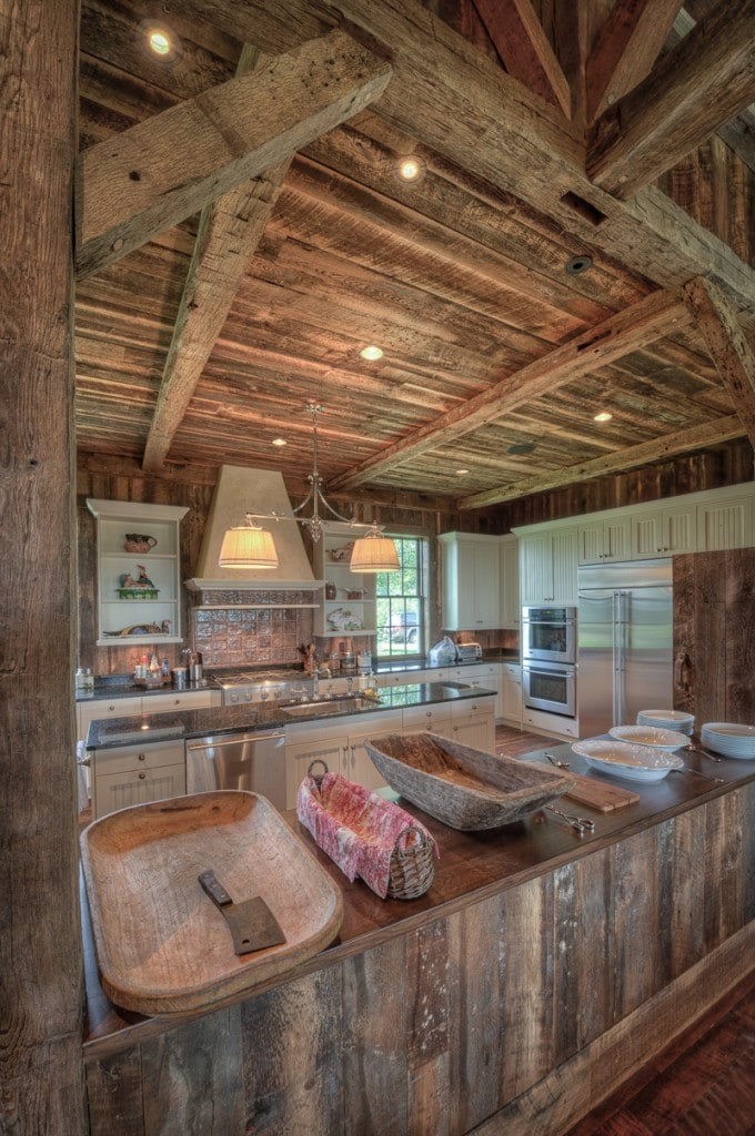 Reclaimed wood beams and barn boards in a party barn kitchen