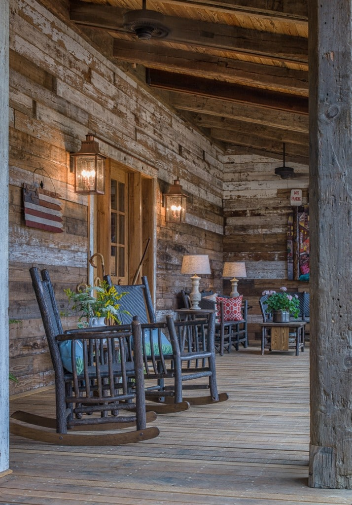 timber frame front porch on the New River with reclaimed wood wall and beams