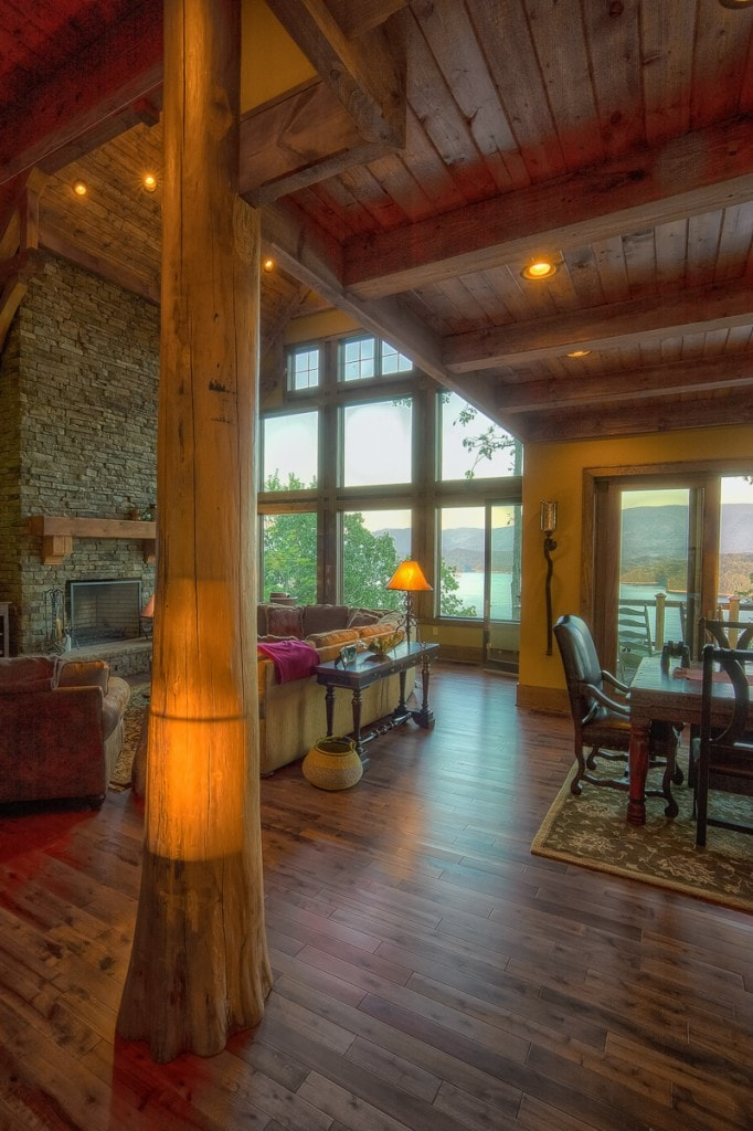 rustic lake house living room with timber framed round log cypress post
