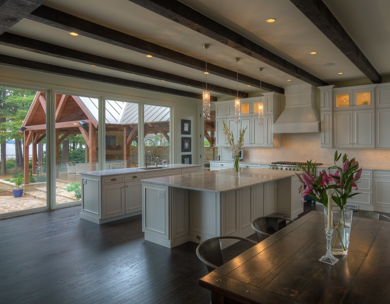 dark wood beams in lake house kitchen