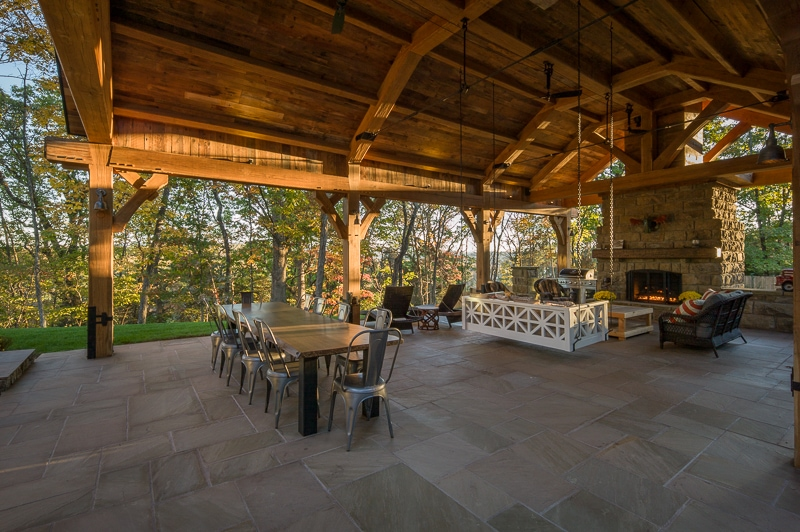 white oak timber frame pavilion with outdoor stone fireplace in Virginia