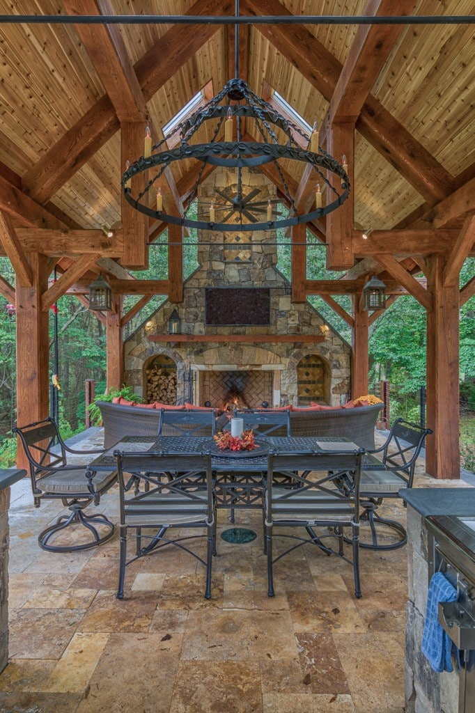timber frame outdoor entertaining pavilion with stone fireplace