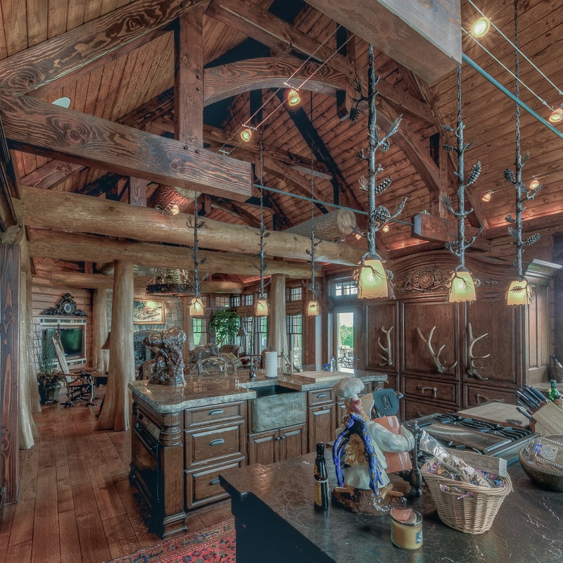 Rustic kitchen with Bald Cypress buttress logs and timber framing