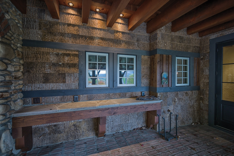 post and beam porch with poplar bark siding