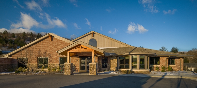Commercial timber frame entry at Hospitality House Boone NC
