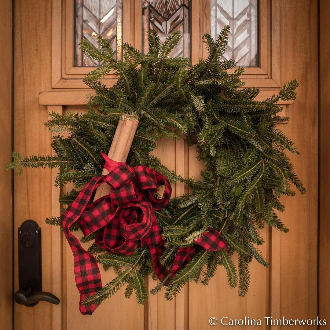 """Warm holiday wishes…and yes, those are 1"""" Oak pegs in our wreath…"""