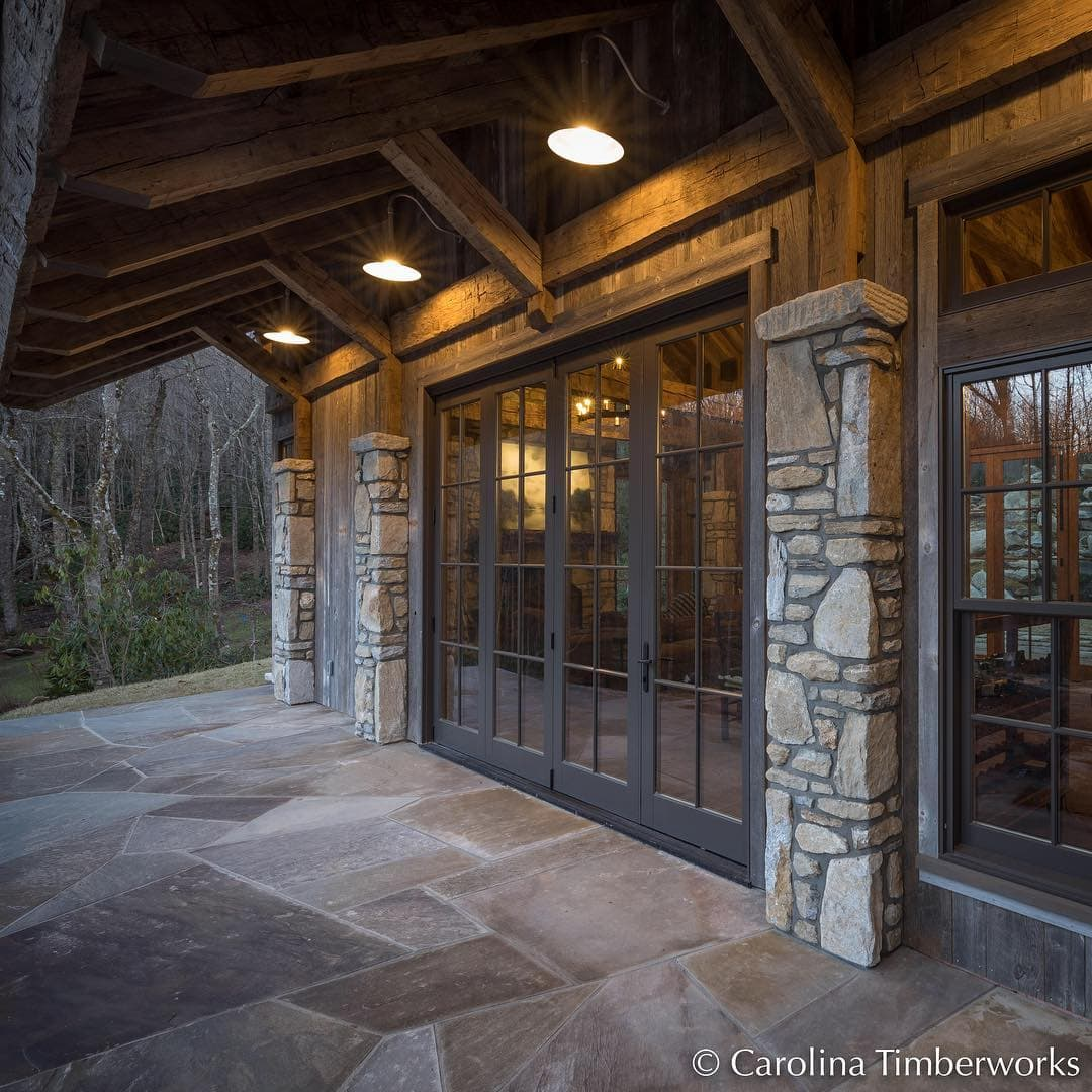 Can't decide why we are so obsessed with this party barn! Is it the combination of timber and stone? The expansive roof overhang?  The proportions in the columns? The black window trim? Maybe ALL of it!
