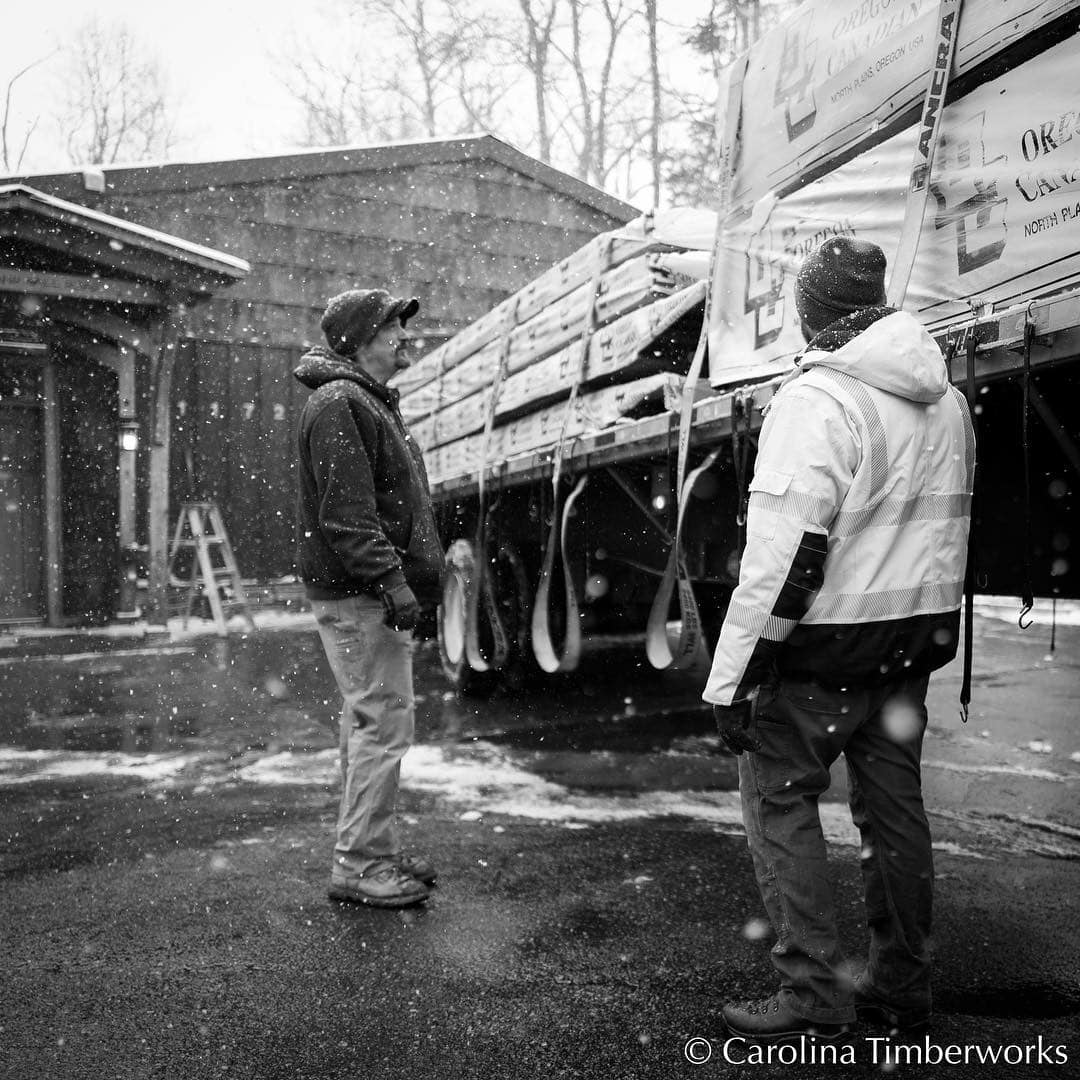 The glamorous side of timber framing: unloading a truck of Port Orford Cedar yesterday in snow, wind, and cold.