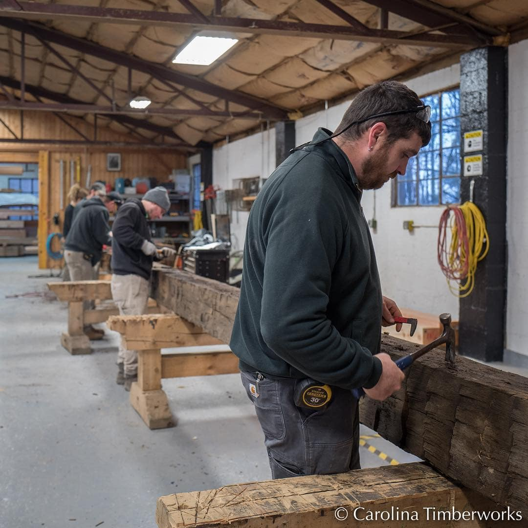 The glamorous side of timber framing: removing metal from reclaimed beams. There are two ways to find the nails, tacks, screws (as well as the occasional bullet) hiding in reclaimed beams:  the slow way (pictured), or the dangerous way (through contact with a saw blade or chisel).