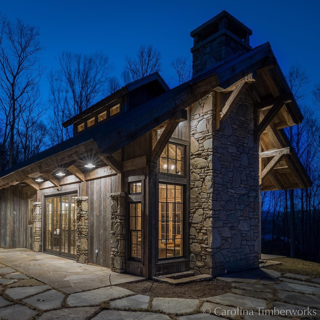 Although from this angle it looks like a little train station, it's actually a party barn with lovely wide overhangs so one can throw open the doors and still shelter the guests.