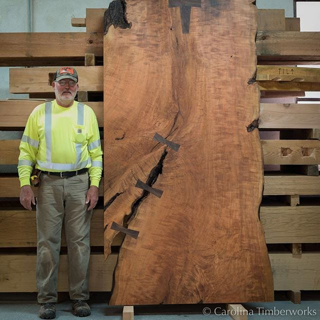 Dwight (who is not a tiny man) and, well, the biggest Cherry slab WE'VE ever seen, whose destiny is to become our client's dream barn door.