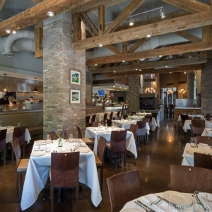 Lighting a Timber Frame can be challenging but we love this execution at in Charlotte, NC. Pass the pimento cheese!