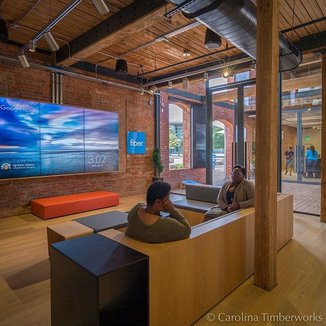 Google fiber reimagined the typical high-tech office space by repurposing a more than 100-year-old historic post and beam building for its new offices in Charlotte, NC. They turned to Carolina Timberworks for historical restoration of the Heart Pine timbers.
