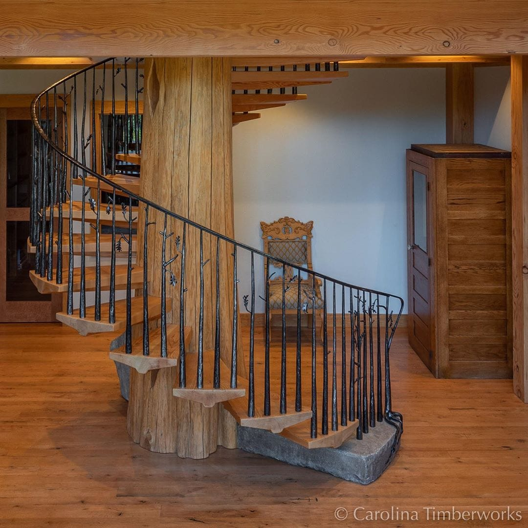 """In honor of Labor Day, a project that took an incredible amount of labor from some equally incredible laborers! We salute you!And now the details: A spiral stair case whose central support is a 24-ft.-long, 3,700 lb Western Red Cedar log which is 36"""" diameter at the base and 24"""" diameter at the top (almost 24' above the floor shown below)."""""""