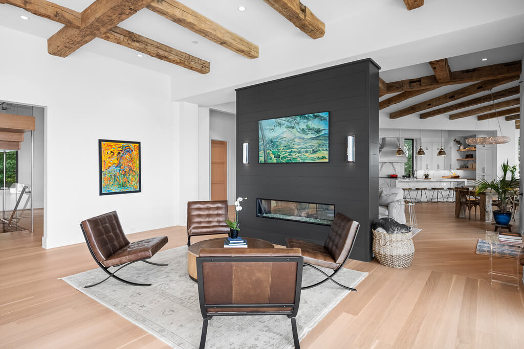 A take on the Modern Farmhouse with reclaimed hand hewn beams