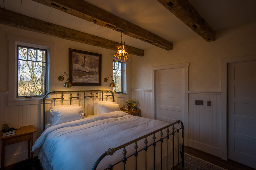 reclaimed beams in bedroom